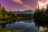 The sunrise over a lake in the park High Tatras. Strbske Pleso, Slovakia, Europe.
