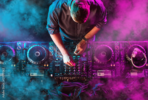 Charismatic disc jockey at the turntable Poster