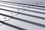 gray corrugated metal cladding on industrial building roof - 121198816