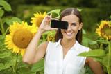Young beautiful girl showing your smartphone screen
