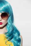 Fototapety Pop art woman portrait wearing blue curly wig and sunglasses. Wh