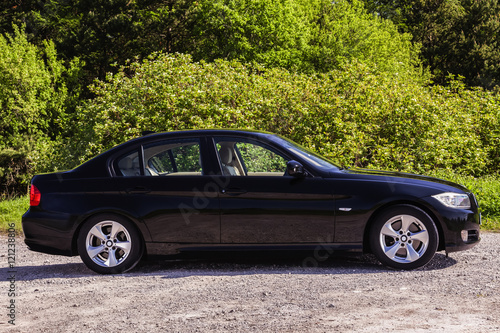 Side view BMW sedan плакат