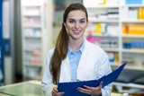Pharmacist holding clipboard folder in pharmacy