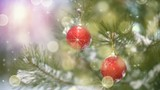 Christmas decoration on tree and fairy snowfall. Slowmotion seamless loop