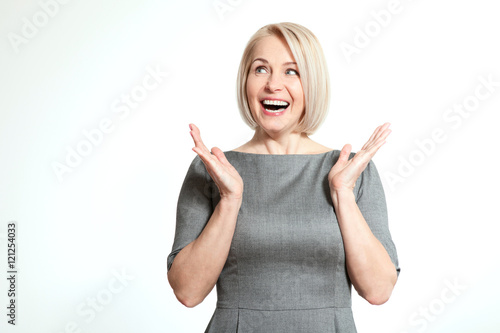 Surprised woman over white background Poster
