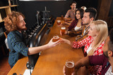 Young People Group In Bar, Barman Give Beer, Friends Sitting At Wooden Counter Pub Top View,  Communication
