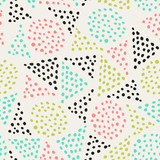 Abstract seamless pattern with hand drawn shapes in green, pink and black on cream background.