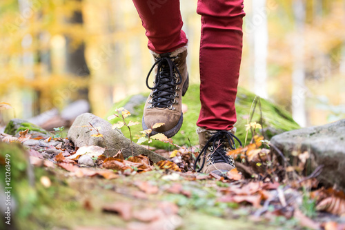 Close up of legs of unrecognizable woman in autumn nature - 121268479