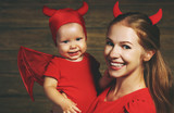 Family mother and baby son celebrate Halloween in devil costume