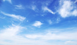 Blue sky background with tiny clouds © Pakhnyushchyy