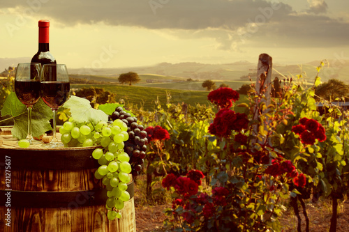Red wine with barrel on vineyard in green Tuscany, Italy © ZoomTeam