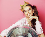 Fototapety young cute disco girl on pink background with disco ball and crown
