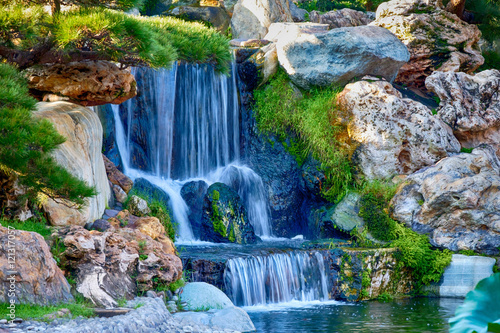 A small waterfall in a garden - 121317057
