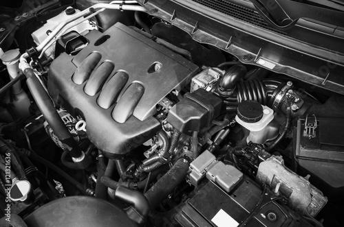Modern car engine under oped hood Poster