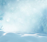 Fototapety Christmas winter background with snow and blurred bokeh