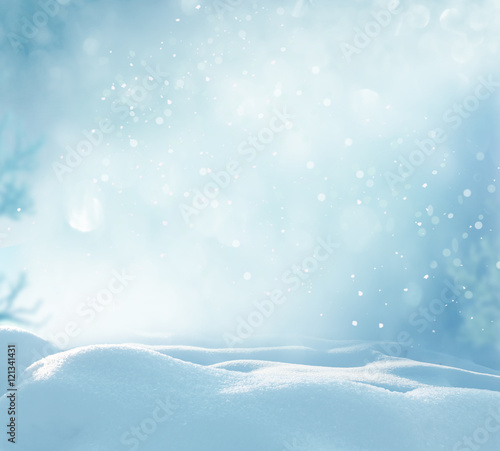Leinwanddruck Bild Christmas winter background with snow and blurred bokeh