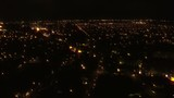 Aerial flight over night city