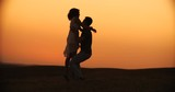 young happy couple dancing wedding dance at sunset, slow motion