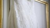 Bride wedding dress hanging on the door - Close up /  2 in 1 Footage