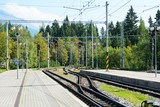 Empty platforms without trains and people at terminal railway station Strbske pleso in High Tatras, Slovakia.
