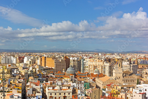 Aerial view of Valencia old city architecture around Central Market (Mercado Central). City skyline with mountains on horizon in Valencia, Spain