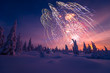 Winter landscape with fireworks.