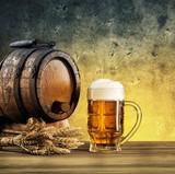 Barrel on stand and mug of beer