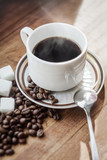 coffee cup with coffee beans and sugar cubes