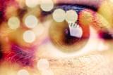 Double exposure of an eye with bokeh