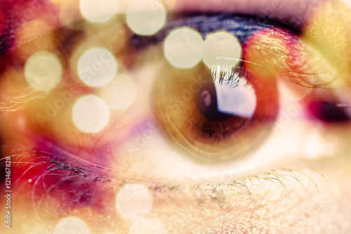 Double exposure of an eye with bokeh