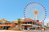 American Village with a huge ferris wheel under the clear sky on June 2, 2013 in Okinawa, Japan.