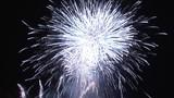 Bright white fireworks against black sky