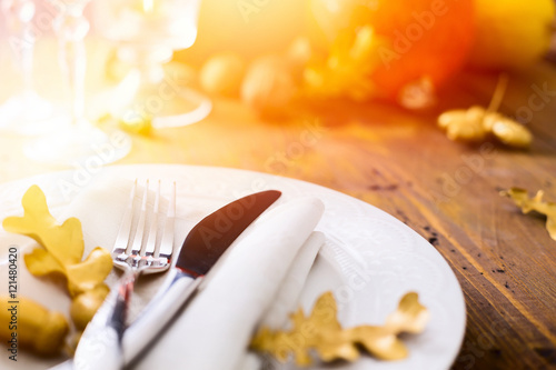 Art thanksgiving background with autumn Pumpkin on the dining ta