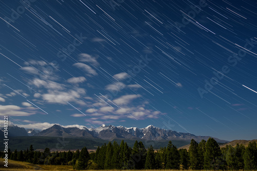 mountains star tracks clouds forest