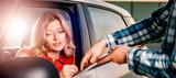 Woman signing car rental agreement