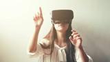 woman uses a virtual reality glasses