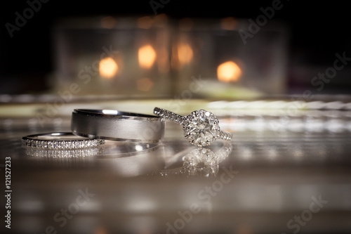 Wedding rings stacked on beautiful background