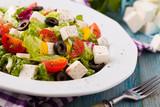 Fresh Greek salad on a plate - 121534099