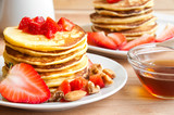 Pancakes with maple syrop and strawberries fro breakfast