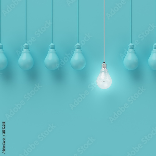 Fototapeta Hanging light bulbs with glowing one different idea on light blue background , Minimal concept idea , flat lay , top
