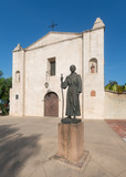 Statue of Junipero Serra outside the church at Mission San Gabriel Arcangel in California