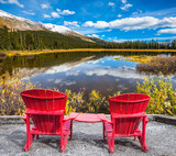 Two comfortable deck chairs on the lake - 121598643