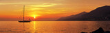 Fototapety Panoramic view of Sailing at sunset with mountains
