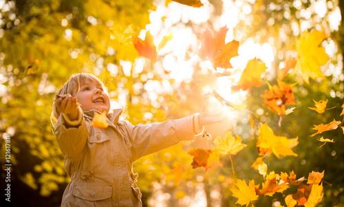 Child enjoying autumn time