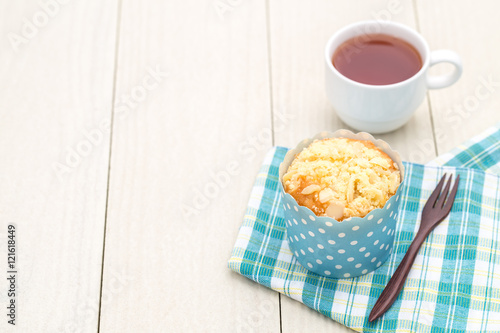 Almond muffin on white wooden table