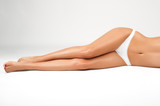 Fototapety Long woman legs isolated on white. Depilation