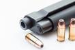 Barrel of a handgun and bullets.