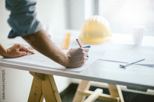 Close up of engineers hands working on table
