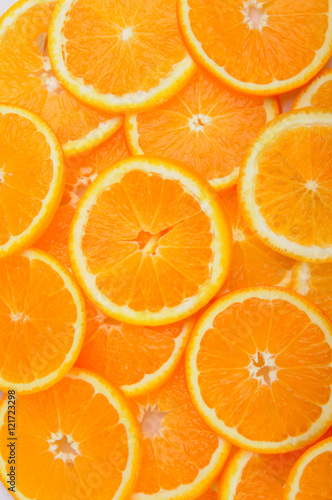 citrus background. juicy slices of orange cover the entire surface - 121723298