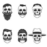 Set of the skulls with hairstyle and hats. Design elements for e